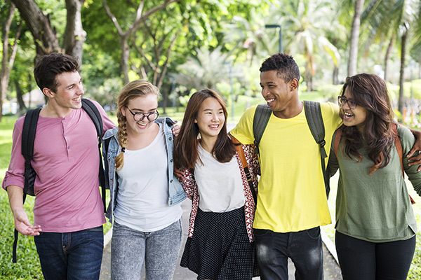 Group of 5 college students looking happy